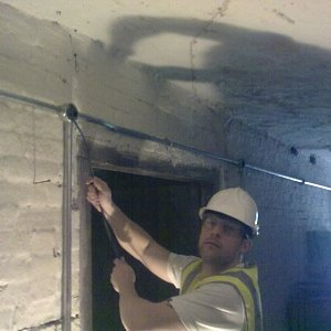 galvanised-steel-conduit-installed-within-a-basement